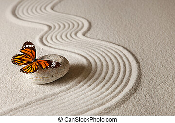 Zen butterfly - Sand background with rock and butterfly