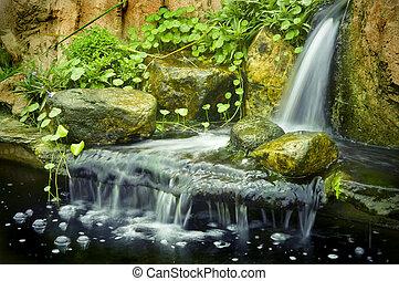 Zen garden - Japanese garden waterfalls, slow shutter.