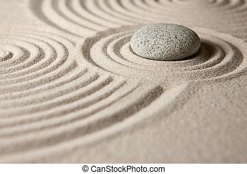 Zen garden - A stone surrounded by sand ripples. Zen concept...