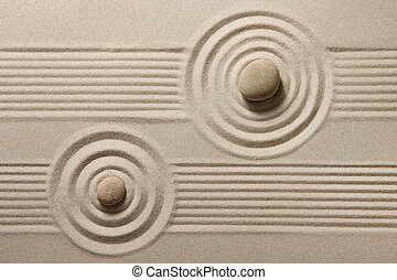 Zen garden - Two stones surrounded by sand ripples. Zen...
