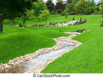 zen garden - stream of water flowing through grassy hills...