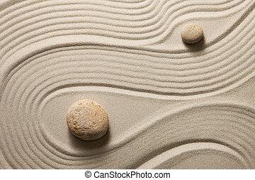 Zen garden - Two stones surrounded by sand ripples. Zen ...