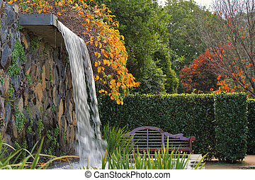 Zen garden with waterfall in Autumn