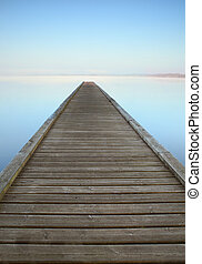 Zen jetty on misty lake - Jetty on misty Azur lake in ...