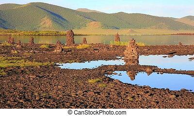 Religious stone structures on lakeshore - Zen like Religious...