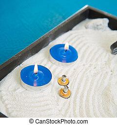 Zen little garden with blue candles and moxa