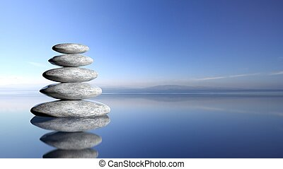 zen, piedras, pila, de, grande, a, pequeño, en, agua, con, cielo azul, y, pacífico, paisaje, fondo.