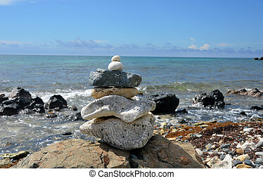 Zen rock stack (1) - A stack of rocks in a Zen pattern with...
