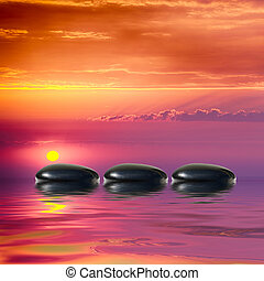 Zen spa concept background-Zen black massage stones reflected in water