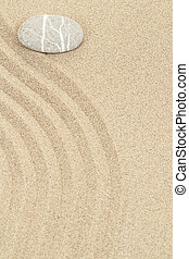 zen stone in sand