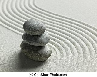 Zen stone in the sand
