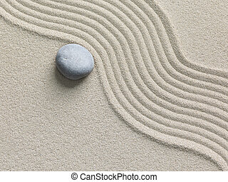 Zen stone in the sand