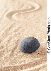 Zen stone Japanese sand garden round rock in sand
