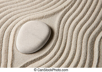 Zen stone - Stone surrounded by sand ripples. Zen concept