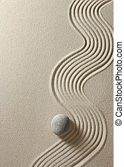 Zen stone - Top view of stone on sand background
