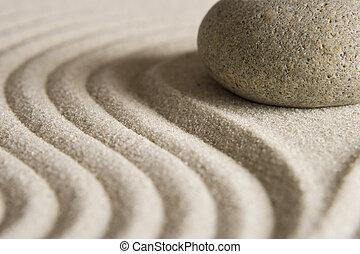 Stone on raked sand; Mini rock garden.