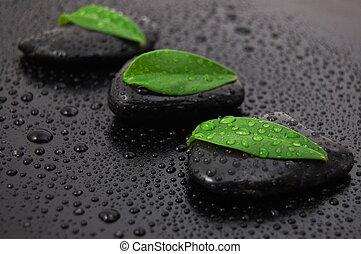 zen stone wellness concept - wellness massage or bath...