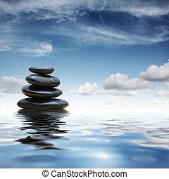 Zen stones in water - Stack of black zen pebble stones...