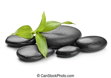 zen stones - zen basalt stones and bamboo isolated on white