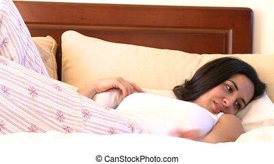 Zen woman lying on bed