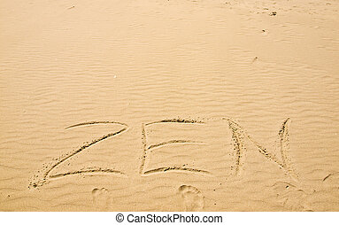 Zen Written in the Sand on a Sunny Day with Footprints