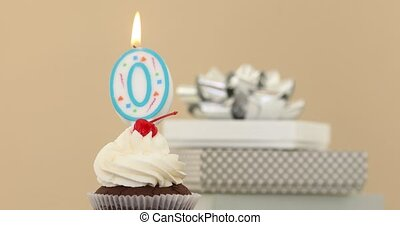 Zero 0 candle in cupcake pastel background - Number zero 0...