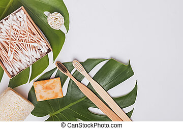Zero waste bathroom essentials, top voew. Bamboo tooth brushes, cotton swabs and other