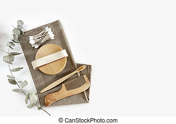 Zero waste concept. Set of eco friendly bamboo toothbrush, cotton buds, natural hairbrush .