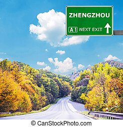 ZHENGZHOU road sign against clear blue sky