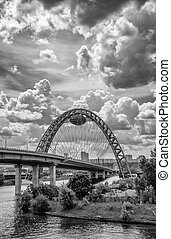 Zhivopisny Bridge the highest in Europe cable-stayed bridge over the Moscow river. Cloudy summer day. black and white.
