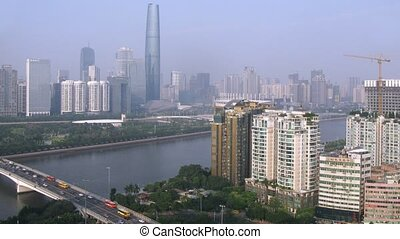 Zhujiang New Town stands on opposite to river bank to which cars on bridge go