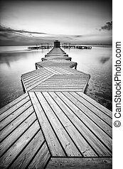 Zig Zag dock at sunrise in black and white