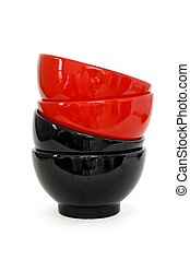 Zigzag stack of two red and two black porcelain bowls isolated