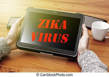 zika virus alert on the Internet at digital tablet
