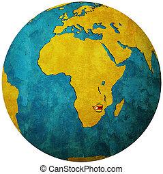 zimbabwe flag on globe map