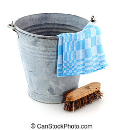 Old zinc bucket with cleaning brush and cloth
