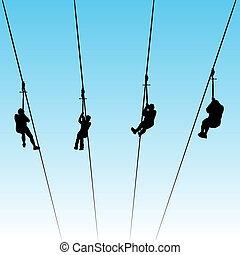 Zip Line Race - An image of women in a zip line race.