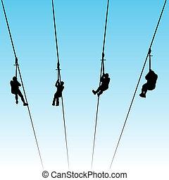 Zip Line Race - An image of women in a zip line race.