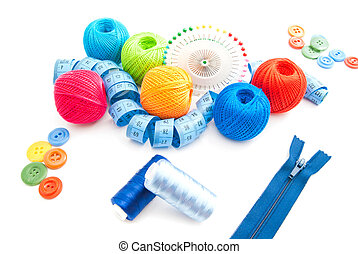 zipper and other items for needlework on white