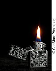 ZIPPO petrol lighter on black background