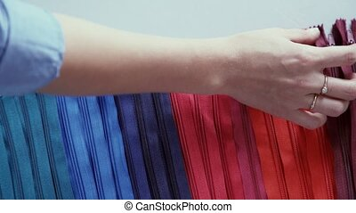 Zips for clothes. Slide fastener for clothes. Multicolored zippers.