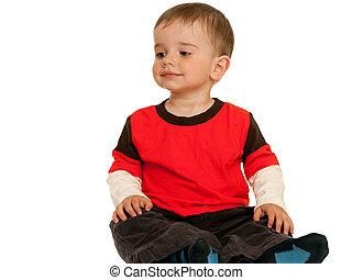 zittende , het glimlachen, toddler