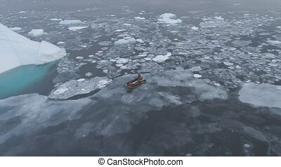 Zodiac boat sail at iceberg tracking aerial view - Zodiac...