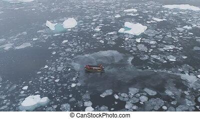 Zodiac boat sail at iceberg tracking top view - Zodiac Boat...