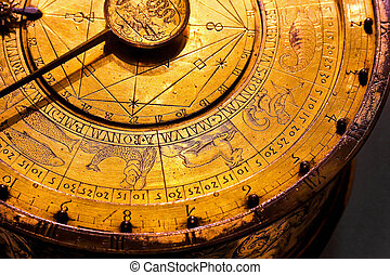 Old astrology clock with golden zodiac symbols