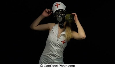Zombie blond nurse girl in gas mask - Footage of sexual...