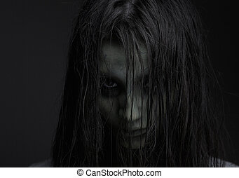 Zombie girl with horror expression - Close up portrait of a...