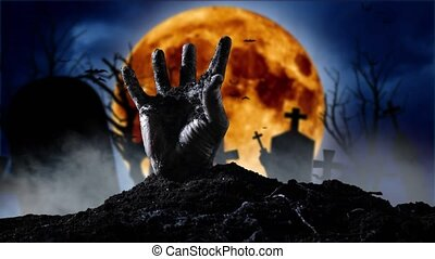 Zombie hand coming out of the grave. Graveyard smoky...