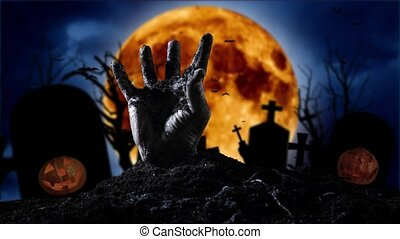 Zombie hand coming out of the grave on the background of the...