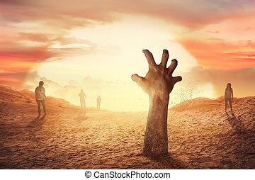 Zombie hand rising from the grave